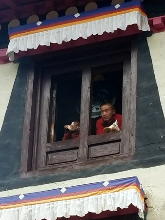 Monks playing conch shell